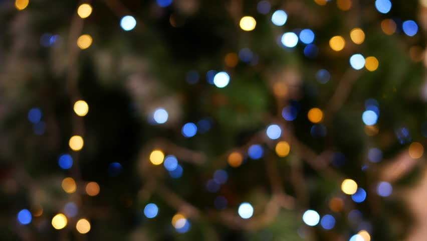 abstract christmas tree background with defocused lights 4k stock video clip - Christmas Lights Video