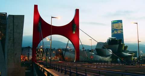 BILBAO, SPAIN - JULY 4, 2017: Guggenheim Museum Bilbao is museum of modern and contemporary art, designed by Canadian-American architect Frank Gehry. Bilbao, Basque Country, time lapse, zoom out