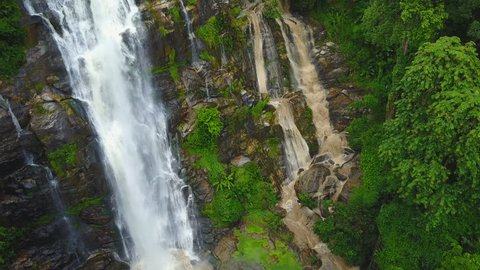 Close approach to waterfall aerial view from drone in rain forest, Wachirathan waterfall in Chiangmai, Thailand.