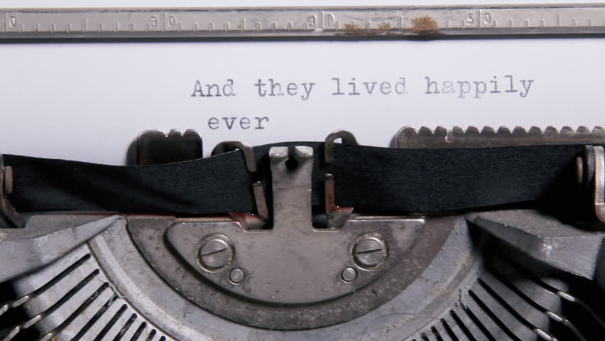 Typing the words - And they lived happily ever after - on a sheet of paper with an old vintage typewriter.