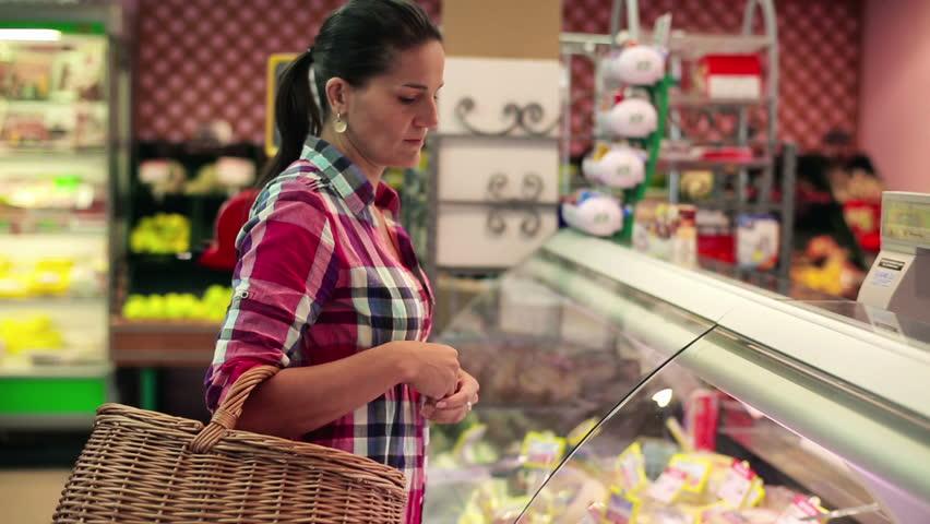 Woman taking groceries from seller in supermarket, stabilized shot  | Shutterstock HD Video #3112507