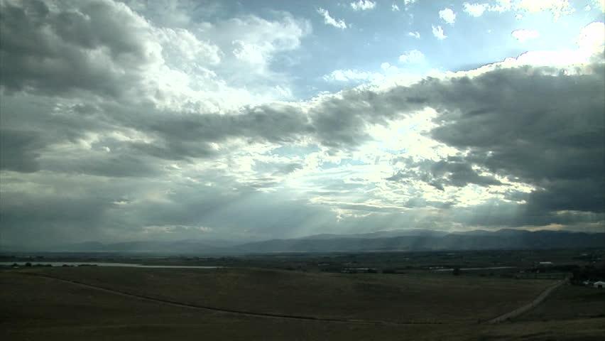 Sun rays beam through cloudy sky | Shutterstock HD Video #31171477