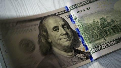 02891 Close-up shot of counting 100 dolar bills