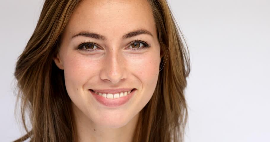 Beautiful brunette smiling to camera, portrait