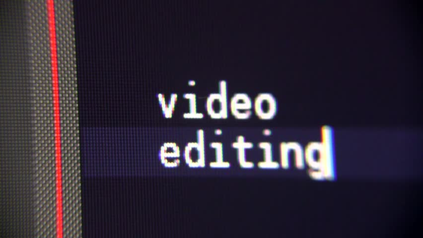 Computer Text - Video Editing. PC screen shows typing title text