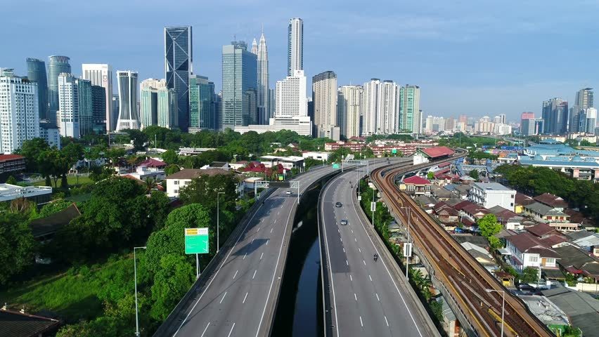 A beautiful perspective of expressway and rail way which lead into the city.