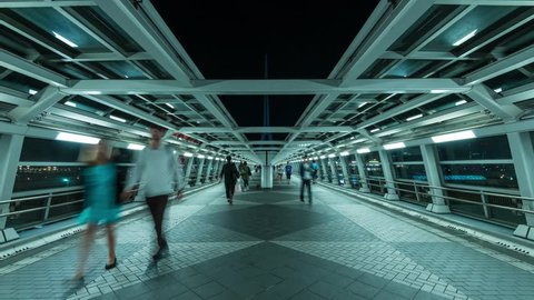 Zooming timelapse footage of people walking at futuristic passageway in Odaiba, Tokyo, Japan