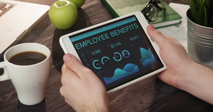 Looking at employee benefits records using digital tablet | Shutterstock HD Video #31354777