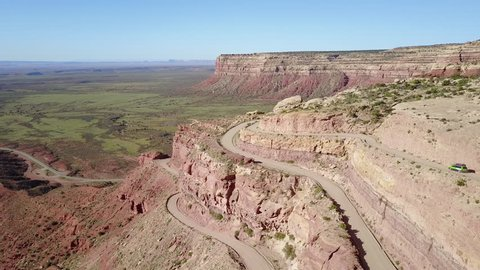 CIRCA 2010s - Shiprock, New Mexico - Aerial as a car travels on the dangerous mountain road of Moki Dugway, New Mexico, desert Southwest.