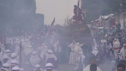 CIRCA 2010s - Antigua, Guatemala - Robed priests carry giant coffins in a colorful Christian Easter celebration in Antigua, Guatemala.