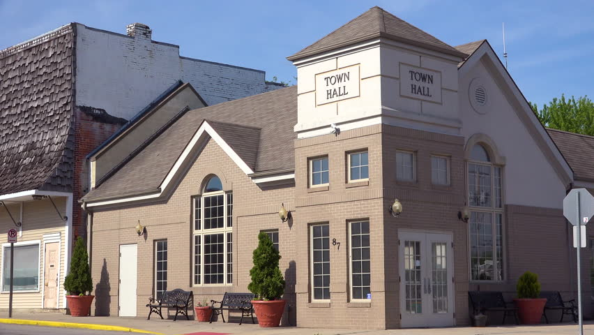 CIRCA 2010s - United States - Generic establishing shot of a town hall or city hall building in a small town.