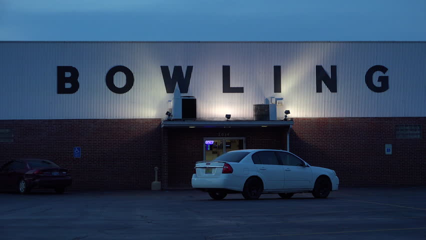 CIRCA 2010s - United States - Establishing shot of a bowling alley at night.