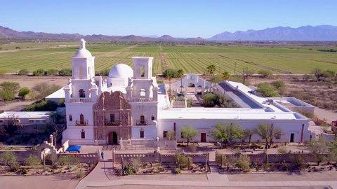CIRCA 2010s - Tucson, Arizona - A beautiful aerial establishing shot of Mission San Xavier del Bac, a historic Spanish Catholic mission near Tucson, Arizona.