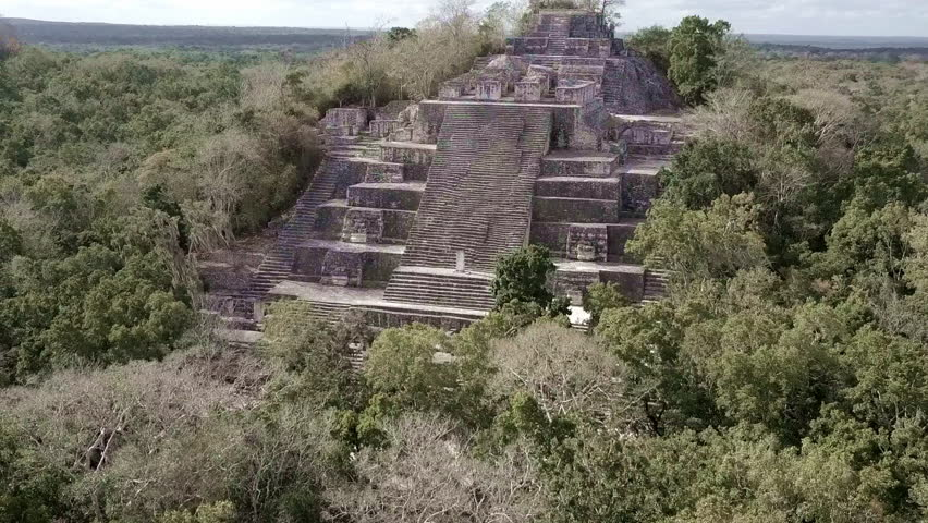 CIRCA 2010s - Yucatan, Mexico - Beautiful aerial flying towards the mayan Calakmul Temple in the Mexican Yucatan.