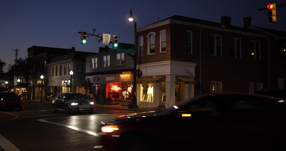 9334 A nighttime establishing shot of businesses on a typical Main Street in America. Pittsburgh suburb.	Building names and addresses obscured.  Day/Night matching available. | Shutterstock HD Video #31396807