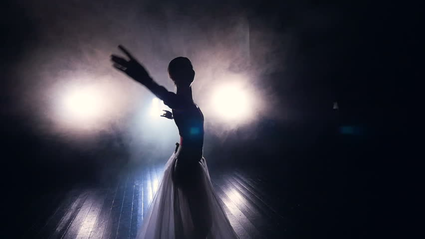 A dancing ballerina comes out from the dark.  | Shutterstock HD Video #31406707