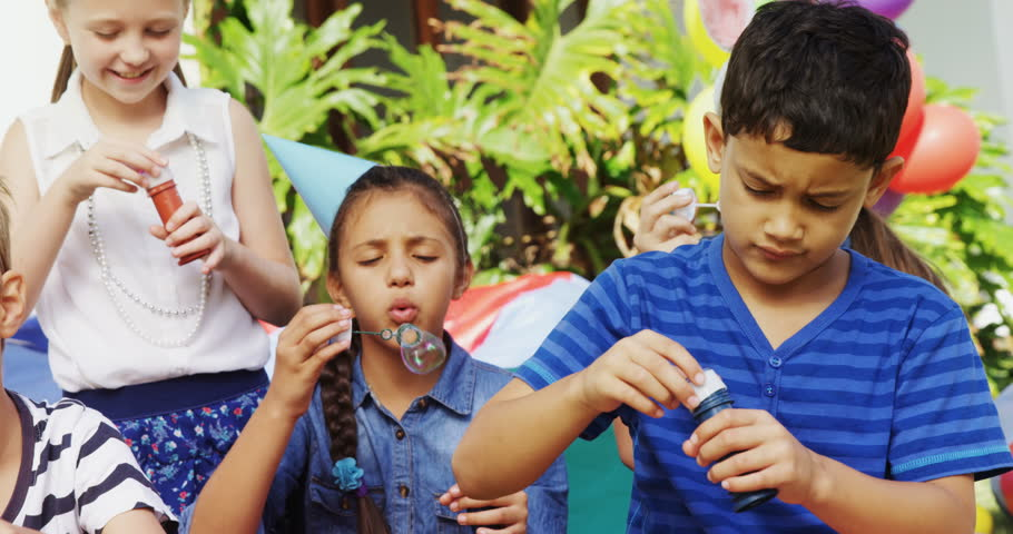 Happy Friends Playing With Bubble Wand In Backyard During Birthday Party 4k