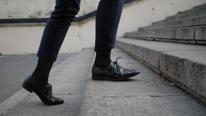 Businesswoman Legs In Black Leather Shoes Walking Up Stairs On Stairway. Sexy Woman near Office after Work. Student girl go to lessons. Slow motion | Shutterstock HD Video #31503757