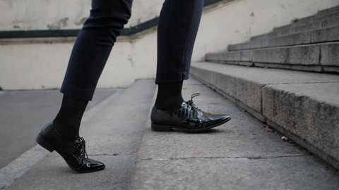 Businesswoman Legs In Black Leather Shoes Walking Up Stairs On Stairway. Sexy Woman near Office after Work. Student girl go to lessons. Slow motion