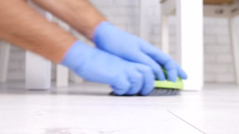 Close Up Man Hands Cleaning Floor Using Gloves a Brush and Wet Cloth (Ultra High Definition, UltraHD, Ultra HD, UHD, 4K, 3840x2160)