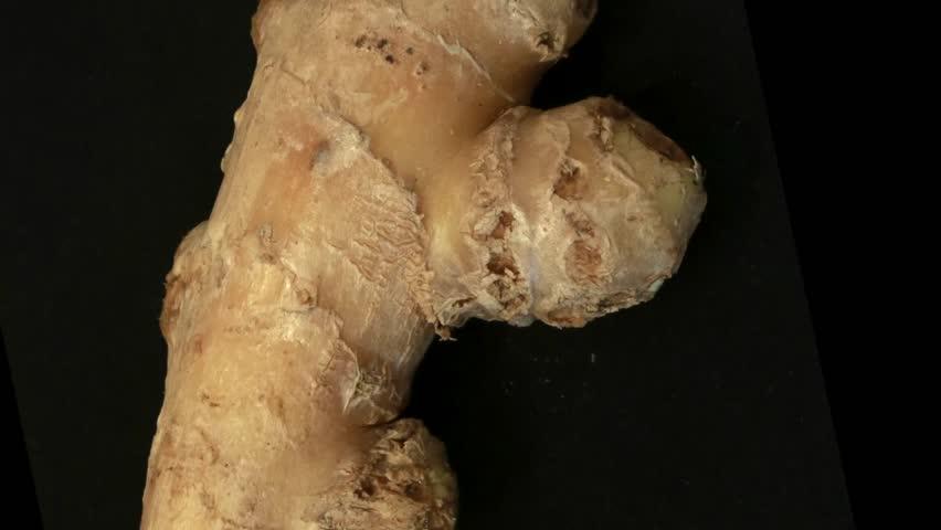 Ginger root on black background