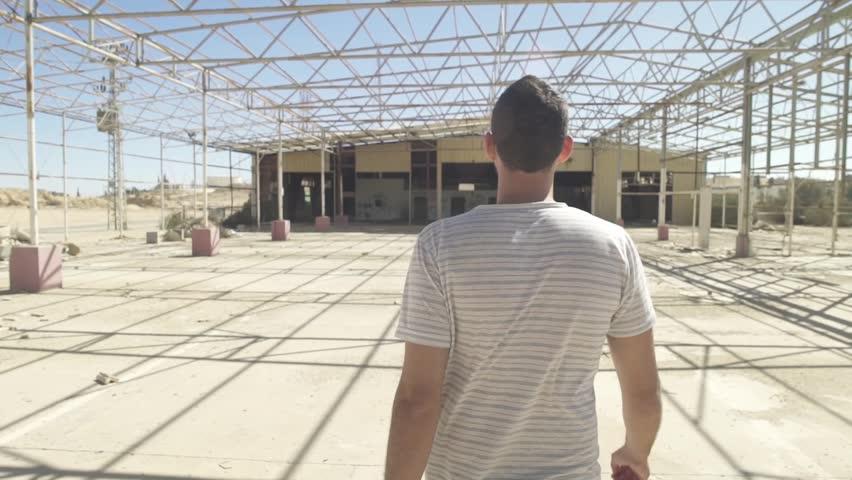 Man walking into an abandoned construction   Shutterstock HD Video #31550890