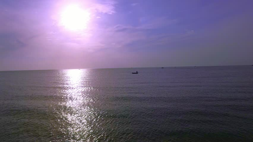 Aerial of fisherman in boat on sea with sunset in Hua Hin, Thailand.