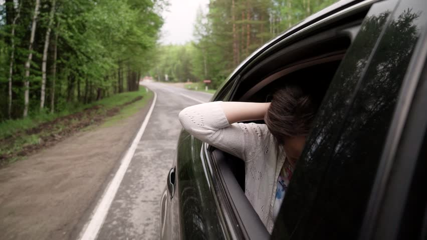 The girl looked out the window of a moving car. | Shutterstock HD Video #31582237