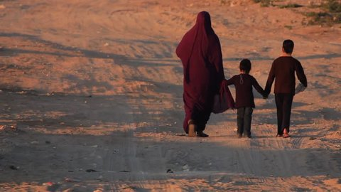 Arab muslim women in Burka/Hijab walking with kids