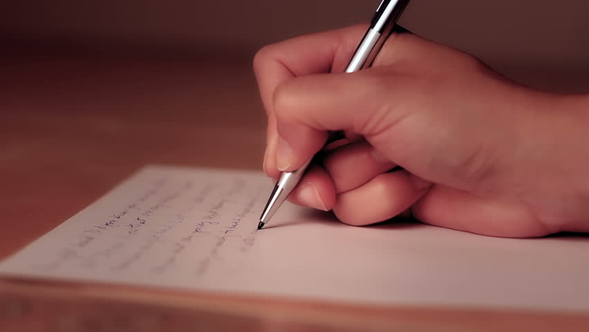 Hand writing letter stock footage video shutterstock female hand writing on a piece of paper with shallow depth of field altavistaventures Images