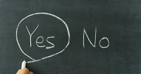 Yes or No decision making - choosing YES on chalkboard