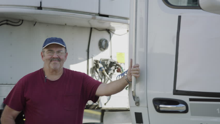 Portrait of truck driver . Fully released for commercial use.