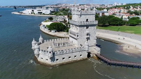 Aerial of Belem Tower Lisbon moving backwards in Portuguese Torre de Belem or Tower of St. Vincent is fortified tower located in civil parish of Santa Maria de Belem in municipality of Lisbon Portugal