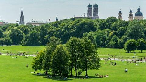 The Englischer Garten (English Garden) with Munich skyline in the background.