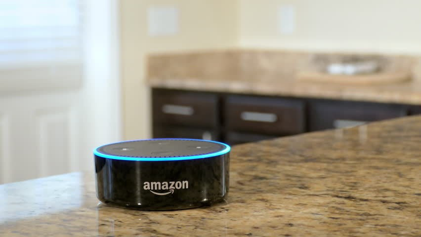 BOSTON, MA - OCT 12: Using Amazon Alexa Echo to control smart home lighting on October 12, 2017. The home automation market is predicted to reach a market value of $12.81 billion by the year 2020.