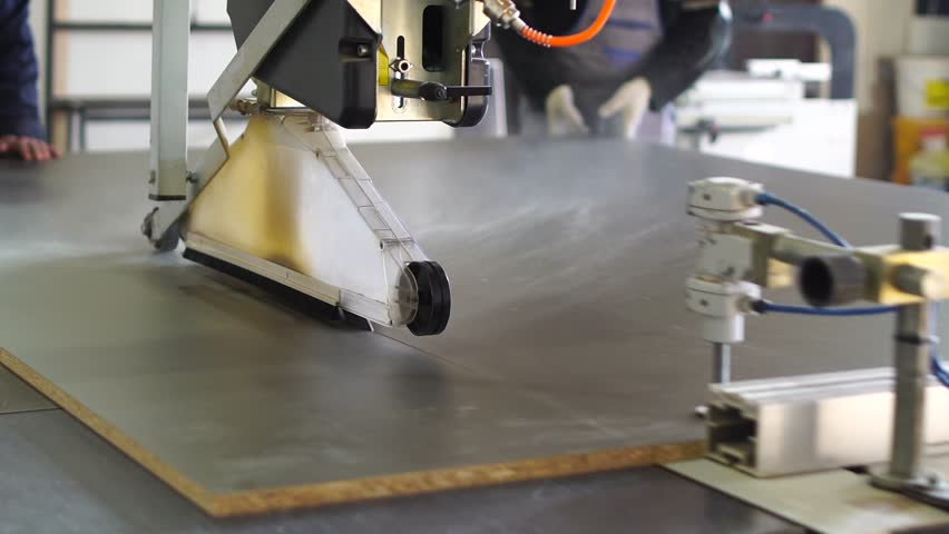 Workshop workers use industrial wood saw machine to cut plywood panels. Furniture production process. | Shutterstock HD Video #31721737