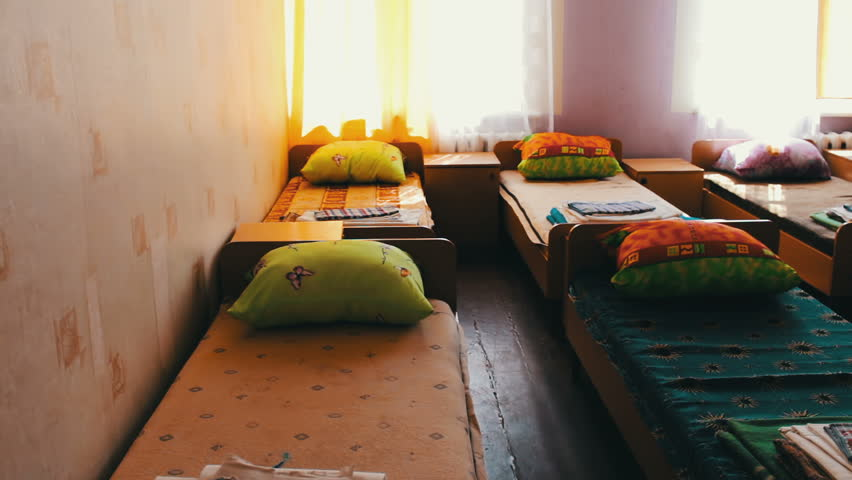 Many beds in a children's camp or hospital