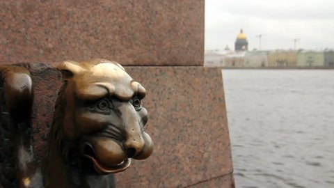Antique bronze griffin on the Neva River, St. Petersburg, Russia. St. Isaac's Cathedral in the background