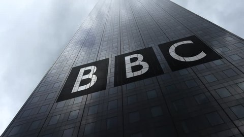 British Broadcasting Corporation BBC logo on a skyscraper facade reflecting clouds, time lapse. Editorial 3D rendering