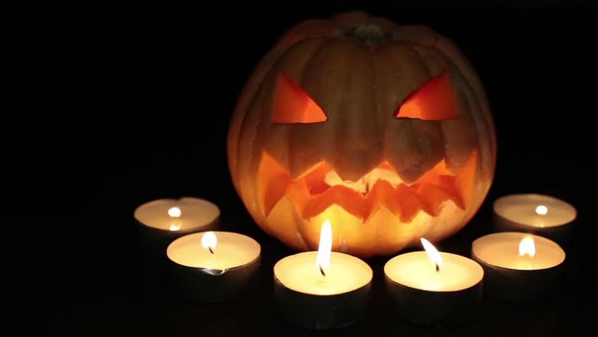 Halloween and All Saints Day. Scary pumpkin lantern. Pumpkin Jack, burning candles.  | Shutterstock HD Video #31807597