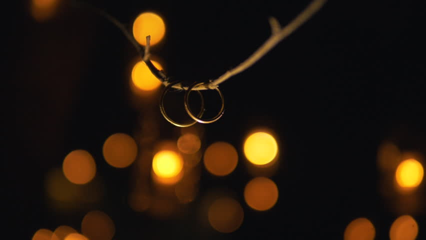 wedding rings hanging on the stock footage video 100
