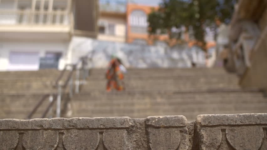 Focus-pull of a woman climbing the steps of a Ganges ghat | Shutterstock HD Video #31829527