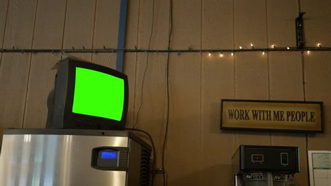 A green screen standard definition TV in a diner for generic use