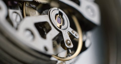 Watch tourbillon rotating macro slowmotion