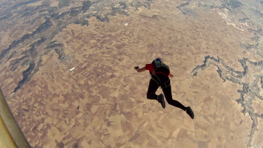 Two skydivers jumping out the plane and flying