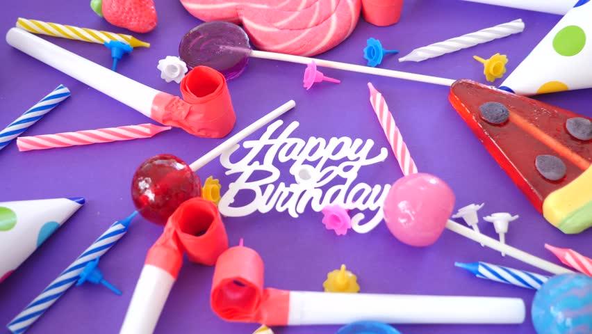 Stock video of video card birthday greeting inscription candies 4k0005video card birthday greeting inscription candies cake candles and holiday caps 4k m4hsunfo