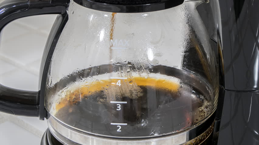 Coffee machine filling pot time lapse with zoom out.   Shutterstock HD Video #31877977