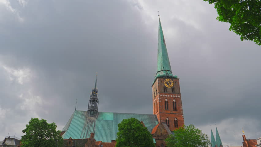 Clock on the facade of Lubeck Dom cathedral church, Germany