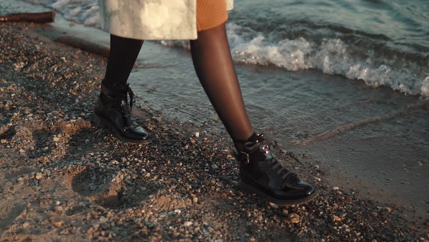 Female legs close-up. the girl is walking along the sand along the seashore | Shutterstock HD Video #31902037