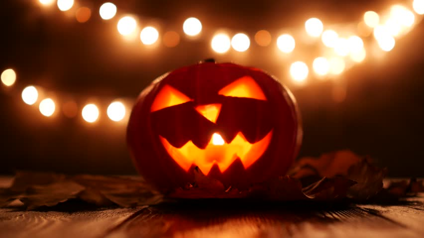 Carved Halloween pumpkin with lights on background. Dark key footage in UltraHd resolution. | Shutterstock HD Video #31903897